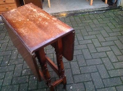 A solid wood small drop Leaf table