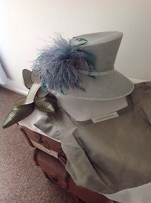 """Beautiful """" DEBUT"""" Pale Green Hat With Feather Display."""