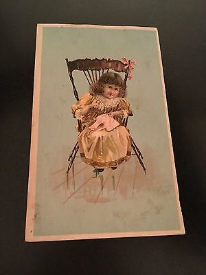 -victorian trade card-- singer sewing machines little girl in chair sewing