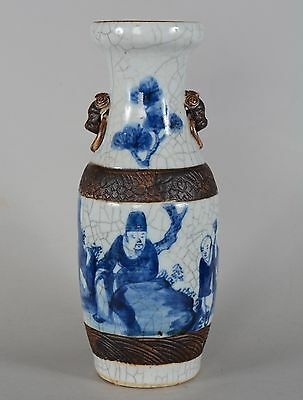 A CHINESE BLUE AND WHITE CRACKLE-GLAZED VASE MAN & SERVANT in ROCK GARDEN