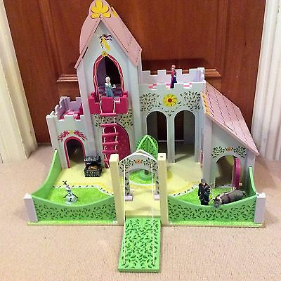 Wooden toy castle with Frozen figures
