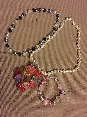 Used ........2 Elasticated Necklaces And 2  Coloured Elasticated Bracelets