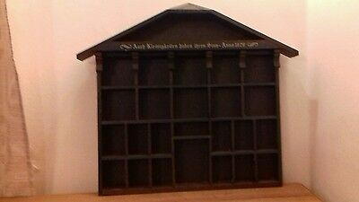 Vintage wooden diplay box with inscription.