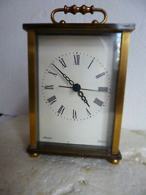 a BRASS QUARTZ CLOCK