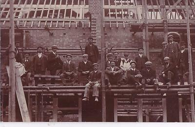 RP RAUNDS BUILDERS ON SCAFFOLDING BY CHETTLE REAL PHOTO NORTHANTS c1910