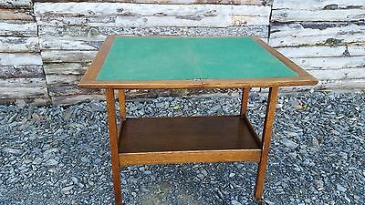 An Unusual Antique Wood Folding Card Table on Casters