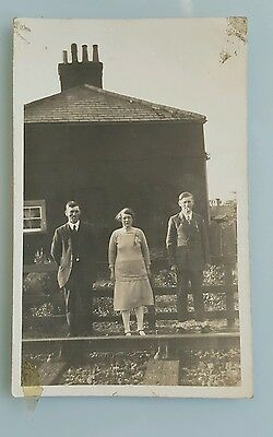 An Old Photo Postcard of a Family Outside House by Railway Tracks