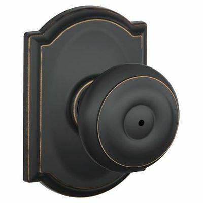 Schlage F40-GEO-CAM Privacy Georgian Door Knobset with the Decorative Camelot Ro