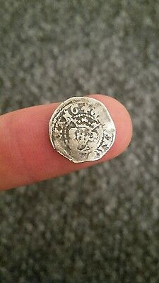 A hammered silver penny of King Edward 1st.