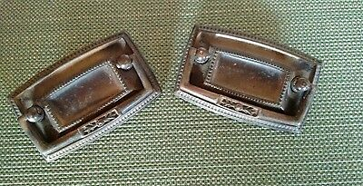 A pair of solid brass drawer pulls