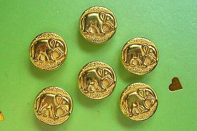 6 gilded metal elephant buttons  16 mm. diameter