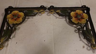 Vintage cast iron garden brackets with painted flowers
