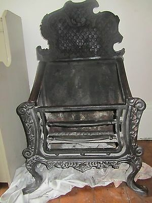 Gorgeous, ornate cast iron fireplace grate