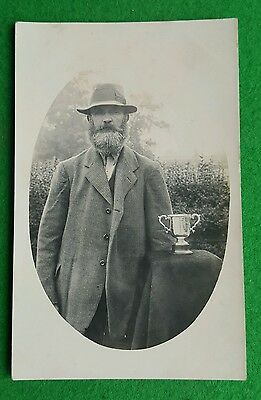 An Old Photo Postcard of Man With Silver Challenge Cup