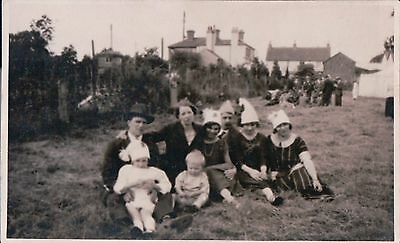 Vintage Postcard Family Group Sat On Grass