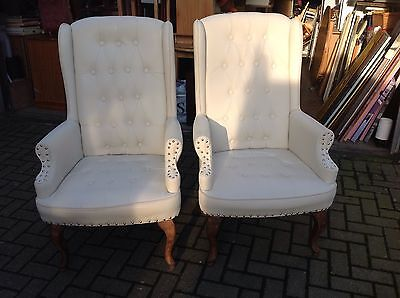 A pair of high back Faux  leather easy chairs