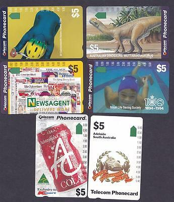 *PHONECARDS.MINT.SIX ASSORTED $5 CARDS.Collector clearance.Lot e.*