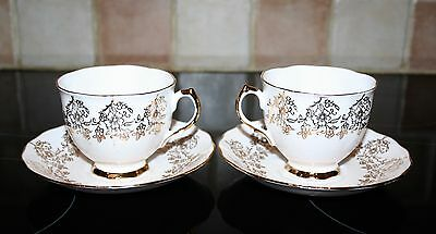 Pretty Vintage Pair Of Crown Royal Gilded Floral Cup And Saucers