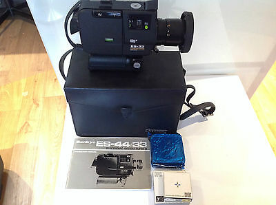 Vintage Sankyo ES-33 Movie Camera in case. Instructions. Filters. Tapes. Faulty