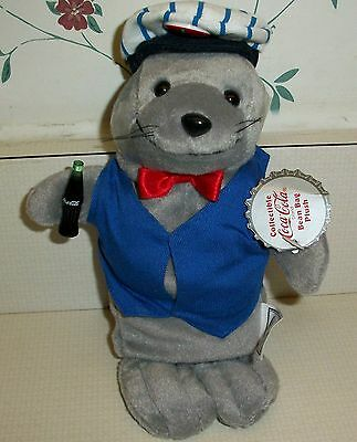 "Coca Cola Plush Beanie ""Seal Wearing Delivery Vest and Capt with Button ""  MWT"