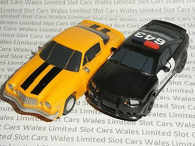 MICRO Scalextric - Pair of Transformers - Bumblebee / Barricade - Exc. Cdn.