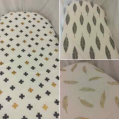 Bassinet, Moses, Boori fitted sheets, gold, grey, feathers, cross, arrows