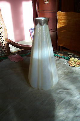 Opalescant white satin glass vase with silver rim, unusual shape.
