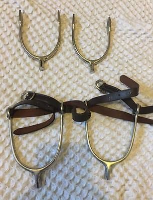 childs spurs and leather straps