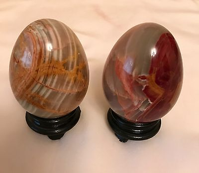 2 PIECES COLLECTABLE MARBLE ONYX EGGS with wooden stand