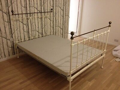Original Antique Victorian Iron and Brass Bed with base. Very good condition.