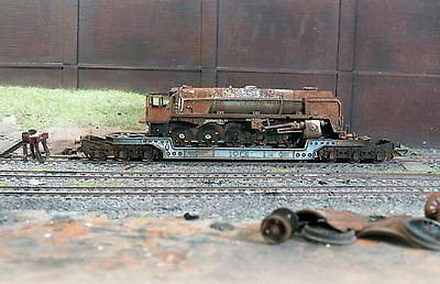 Scrapyard BR 9F loco on a low loader, heavily rusted & weathered