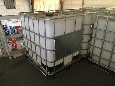 Used 275 Gallon Tank In Wire Cage