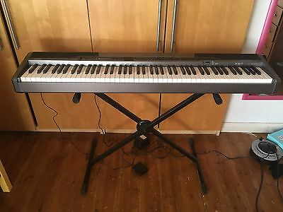 Casio PX-320 Digital Piano with stand, pedal and power pack.