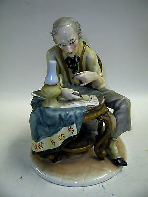 STAMP COLLECTOR FIGURINE     (up) Saint Francis Hospice