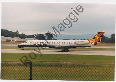 Colour print of British Airways Embraer ERJ 145 G-EMBB at Manchester in 1999