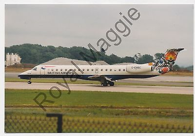 Colour print of British Airways Embraer ERJ 145 G-EMBC at Manchester in 1999