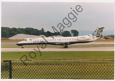 Colour print of British Airways Embraer ERJ 145 G-EMBD at Manchester in 1999