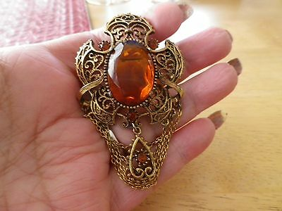 Beautiful  vintage  brooch with chain details and huge amber stone by Exquisite