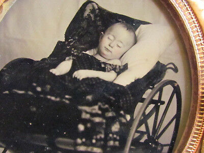 young child sleeping or post mortem in a large buggy ambrotype photograph