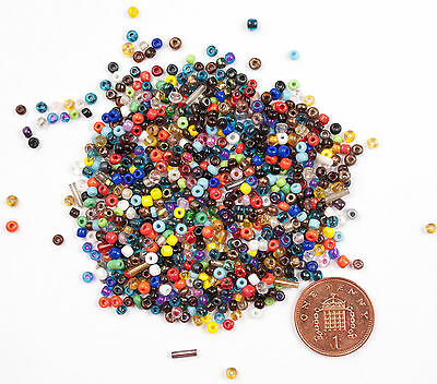 Hundreds of tiny coloured glass beads for crafts or jewellry