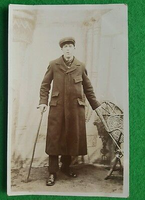 An Old Photo Postcard of a Man in Coat with Stick