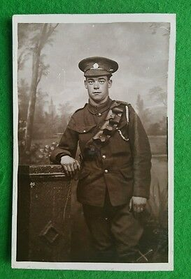 A WWI Photo Postcard Army Service Corps Soldier Reading Studio