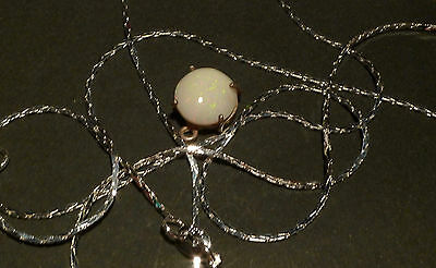 3.0 carat white opal set in sterling silver with chain