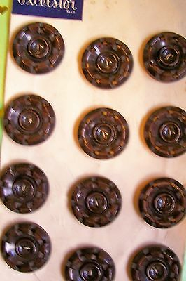 A set of vintage brown marbled buttons in a pierced wheel pattern 3 cms. diam.