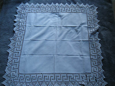 vintage white tablecloth with hand crochet edge.