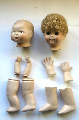 TWO J.D.KESTNER BISQUE REPRO DOLLS HEADS   and  6 limbs.