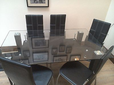 Glass Dining Table & 6 Black Chairs