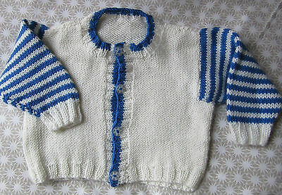 HAND KNITTED WHITE CARDIGAN - BLUE/WHITE STRIPED SLEEVES   approx. 6  - 12 mths