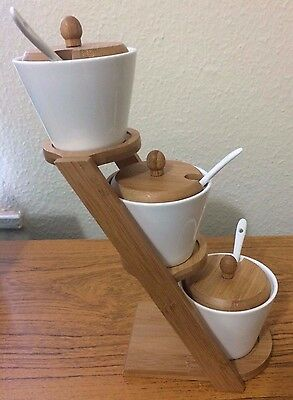 3 Stacked Sauce pots and holder