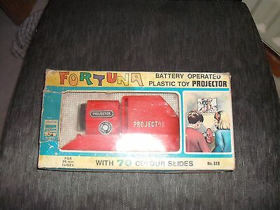 Fortuna ,battery operated ,plastic toy projector + all,10 sets of slides